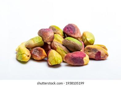 Macro shot of fresh pistachios shelled and unshelled.