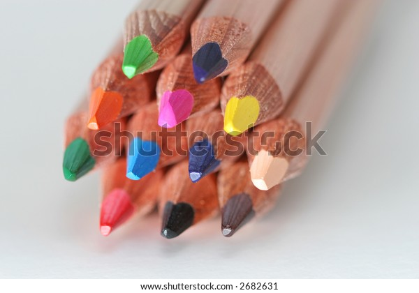 A macro shot of the front end of a group of colored pencils, isolated