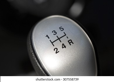 A macro shot of a gear stick. The knob is from a quite new 5-speed manual car. Image taken with natural light using a macro lens.