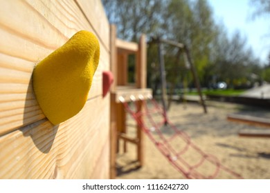 Macro shot of a handle on a freeclimbing wall on a public wooden playground in Berlin, Germany