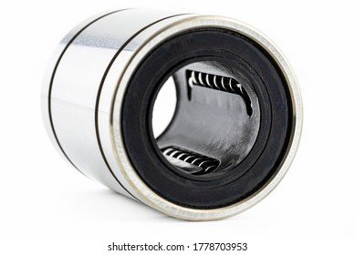 Macro shot of the inside of a linear bearing, isolated on a white background, selective focus.