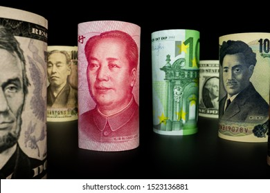 Macro shot of international currency money include US American Dollar, Euro Currency, British UK Pound, Australian Dollar, China Yuan and Japan Yen. Foreign currency money exchange and Forex concept.