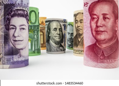 Macro shot of international money include US American Dollar, Euro Currency, British UK Pound, Australian Dollar, China Yuan and Japan Yen. Foreign currency money exchange and Forex concept.