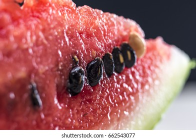 Macro shot of a juicy watermelon slice on the table