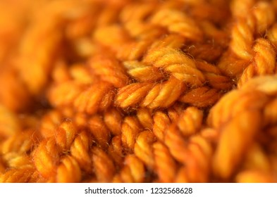 Macro shot of a knitted and purled pattern