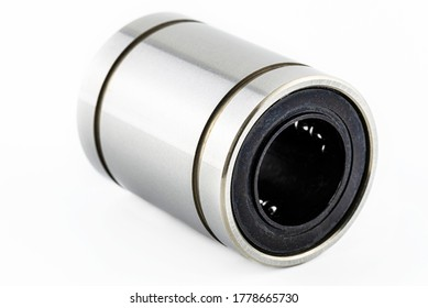 A macro shot of a linear bearing isolated on a white background.