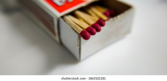 Macro shot of matchsticks coming out of the box
