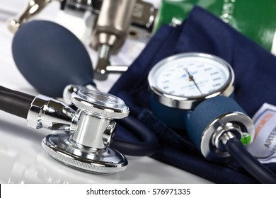 Macro shot of medical equipment with focus on stethoscope.