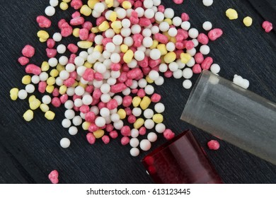 A macro shot of medicines, red capsules. Pill with colorful granules.
