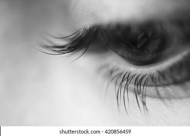 Macro shot of a melancholic eye in black and white