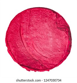 Macro shot od a lipstick swatch isolated on white background. Red lipstick sample