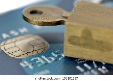macro shot of an old credit card with pad lock and key