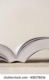 Macro shot of open book. Shallow depth of field. Vertical.