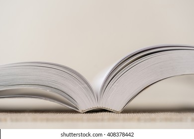 Macro shot of open book. Shallow depth of field. Horizontal.