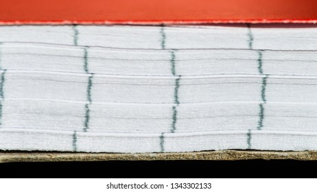 A macro shot of the pages of a notepad.
