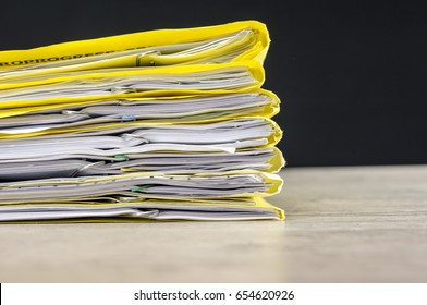 Macro shot of a pile of folders and files with paperwork