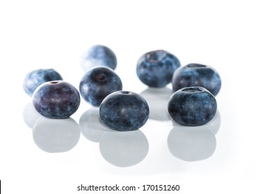 A macro shot of a small group of blueberries.
