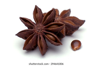 macro shot star anise isolated in front of a white background