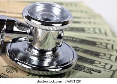 Macro shot of a stethoscope on American money.