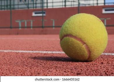 Macro Shot tennis ball whit court