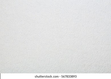 Macro shot of a terrycloth texture background. white Textile floor covering. Grey Knotted-pile carpet