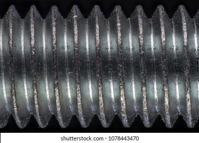 Macro shot of a threaded bolt.