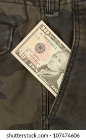Macro shot of trendy jeans with american 10 dollar bill on its pocket