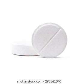 Macro shot of two medical round pills isolated on white background
