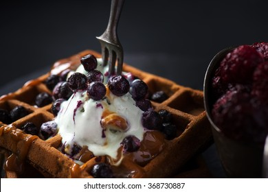 Macro shot of waffles with pistachio ice cream, blueberries