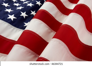 macro shot of wavy American flag with foreground stripes in focus and soft  stars background