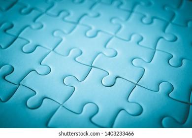 macro shot of white plain jigsaw, step of success concept