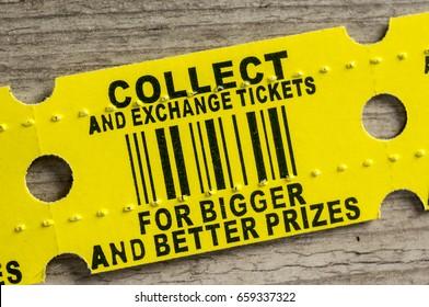 Macro shot of a yellow arcade prize ticket