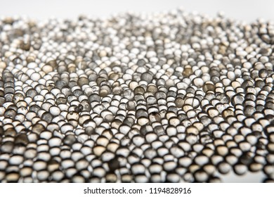 Macro of silica gel balls laying on white background.Its use to prevent mold, mildew, corrosion, odours and other moisture damage