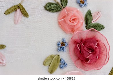 Macro of silk embroidery on damask cloth