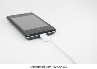 Macro Smartphone connect with charger isolated on white background