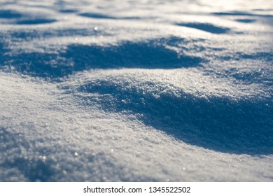 macro of sparkling snow in golden evening sun with shallow depth of field