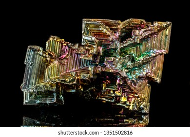 Macro of the stone bismuth mineral on a black background close up