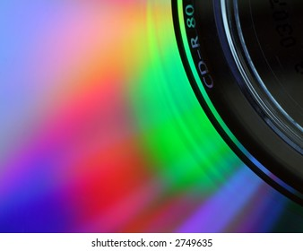 Macro of the surface of a compact disc, with light being diffracted into a spectrum of colours.