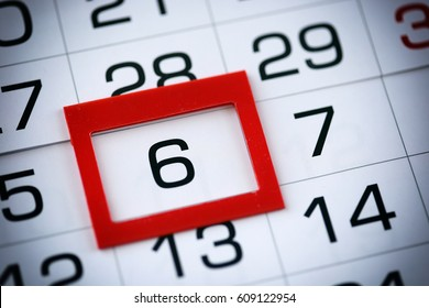 macro texture background page of calendar with date of 6 selected red pointer