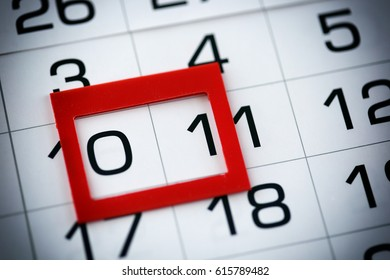 macro texture background page of calendar with date of 10-11 selected red pointer