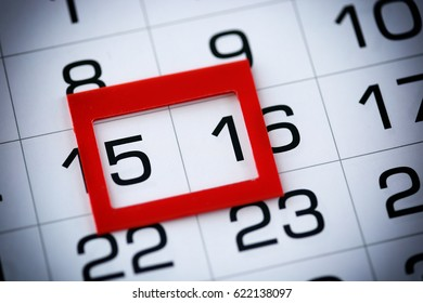 macro texture background page of calendar with date of 15-16 selected red pointer