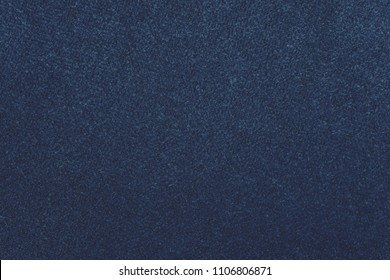 macro texture of fabric of a velvet of blue color for an abstract background or for wallpaper