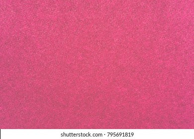 macro texture of fabric of a velvet of pink color for an abstract background or for wallpaper