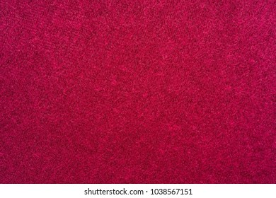 macro texture of fabric of a velvet of red color for an abstract background or for wallpaper