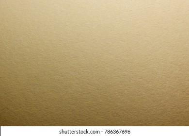 Macro. Texture of natural matte paper. Gold toning.