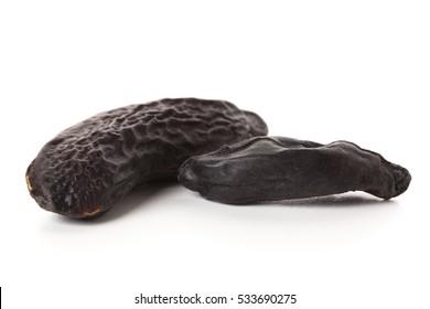 Macro of tonka beans isolated on white background