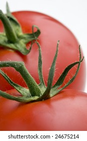 Macro of two ripe tomatoes. Studio shot.