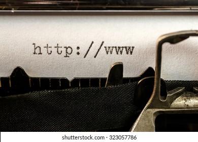 Macro of url text beginning written by old typewriter machine