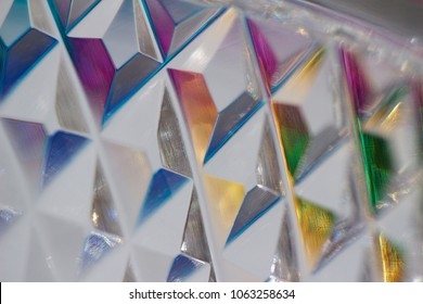 Macro view of beautiful translucent lead crystal glass patterns reflecting color in natural light