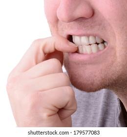 a macro view of biting nails